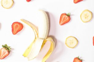 Sliced bananas and strawberries arranged in a pattern | Eating Healthy on a Budget